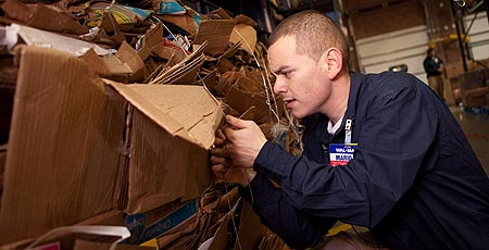 Walmart worker recycling cardboard