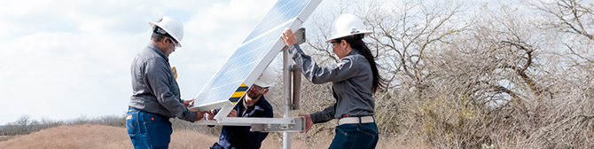 engineers installing a solar-powered methane detector
